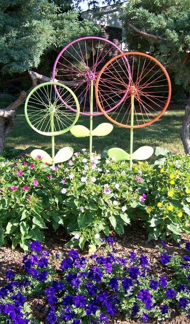 Before taking that old bike to the junkyard, consider this garden ornament idea from The Hanky Dress Lady: Bicycle Wheel Garden Art - Steel Magnolias.: