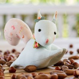 Create your own cute squirrel softie with this squirrel pattern from Simone Gooding, embellished with a satin-stitch nose, striped ribbon and vintage button.