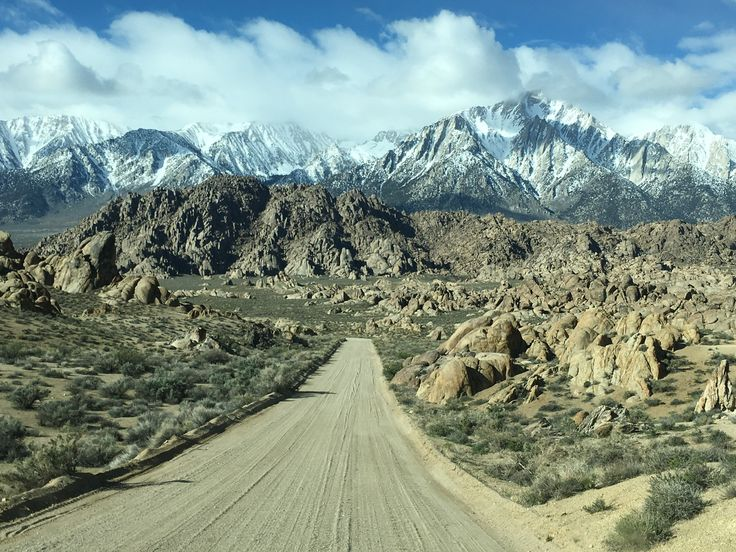 Alabama Hills dusty road under the shadow of Mt. W ... - Alabama Hills dusty road under the shadow of Mt. Whitney 14,000 ft. mountain range High Sierra Nevada. Road through Alabama Hills Where many western movies have been filmed. Popular rock climbing destination. Mt. Williamson in background.