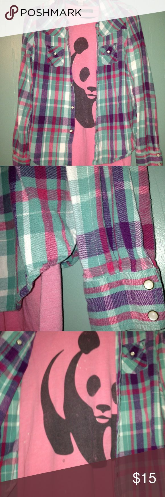 Mossimo Flannel & WWF Panda Tee Plaid flannel shirt by Mossimo (Target) in gently used condition. The fabric is a little fuzzy just from normal washing. Colors are blue, pink, white and purple. Pearled snap buttons on wrists and breast pockets. Size large but runs small. Pink/black World Wildlife Federation pandabear tee is size XL but runs small as well! Has a couple bleached spots but they just add to the retro look! Bundle discount 2-20% 3-25% 4-30%. Just let me know before buying 2 or 4…