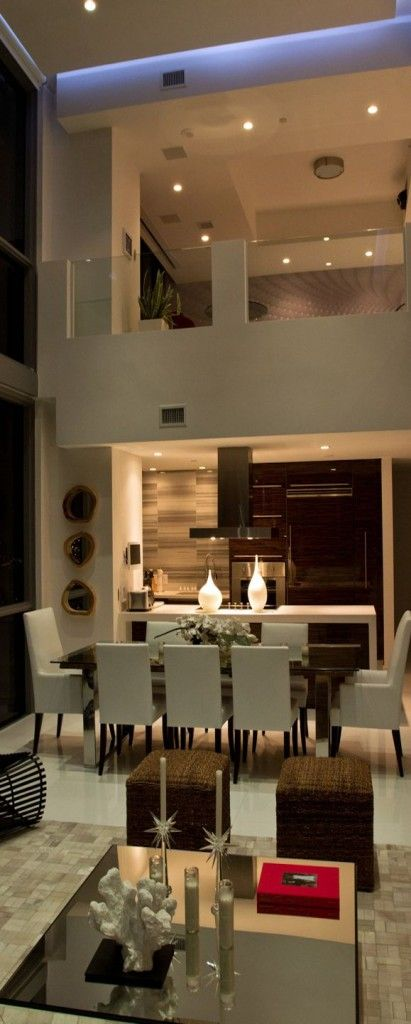 This modern dining room with great accent pieces and huge ceilings would be perfect for entertaining.