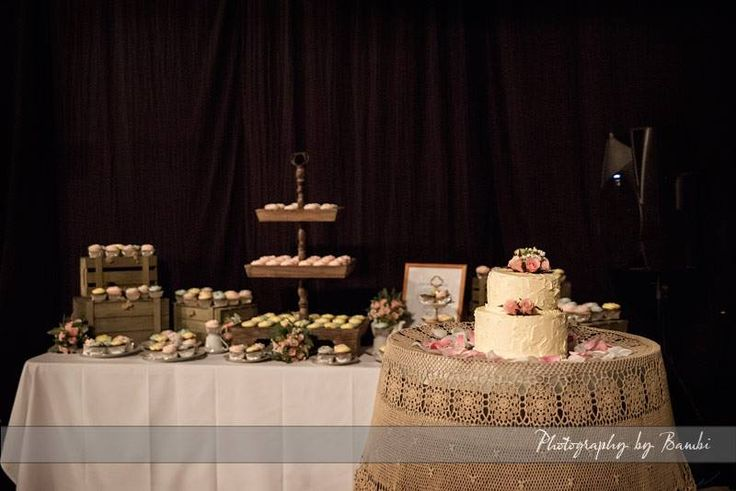 Coffee coloured lace table cloth draped over a wine barrel for the wedding cake display.