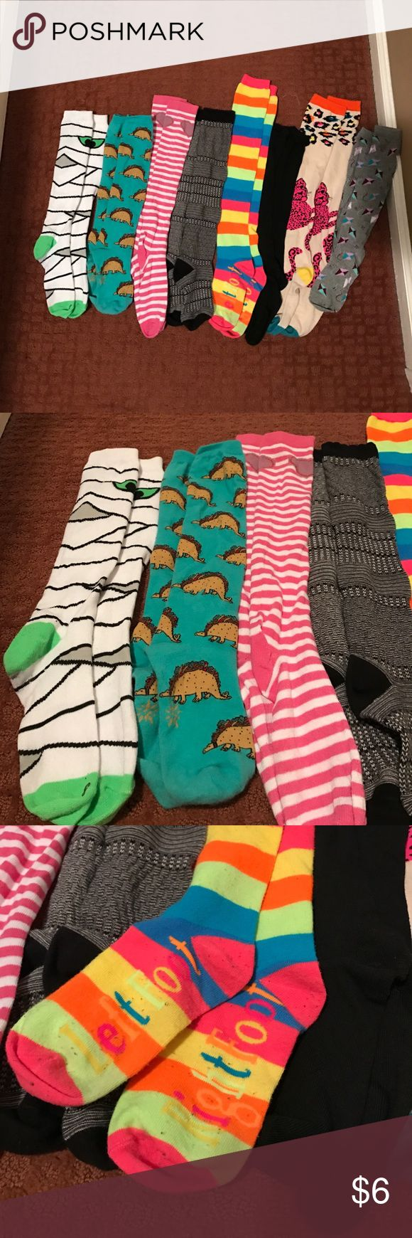 Eight Pairs of High Socks Mummy socks. Taco Dinosaur socks. Striped heart socks. Black gray thick socks. Neon striped left foot right foot socks. Black ruffle top socks. Cheetah socks. Kite socks. ALL socks are knee high or a bit below the knee. Few pairs have been worn more than 5 times. From a smoke-free and pet-free home. Other