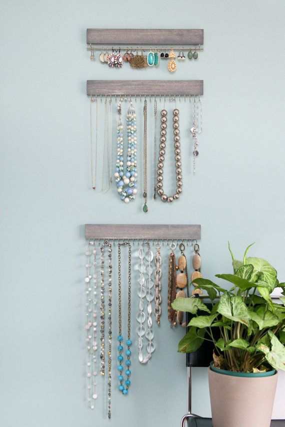 This listing is for a three piece set, one earring rack and two necklace racks. Two stained (driftwood gray) and waxed wood necklace displays with 23