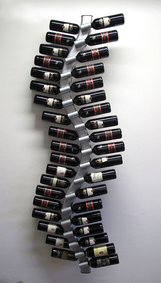 """Vitis wall (cod. VWS38) Vitis wall is a metal bottle holder born from the idea of recreating the plant of the vine that produces the grapes. The """"S"""" sinuous shape and the disposition to wall with 2 files (one inside and one outside) gives bottles a unique visual effect. Vitis is fixed to the wall with 2-fixing brackets placed on the back of the object. Vitis can support until 38 bottles. For many info, contact me."""