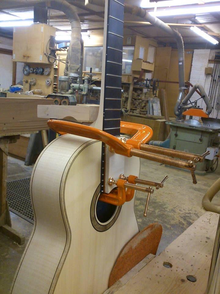 Fitting neck/fingerboard on a steel string guitar.
