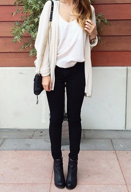 Back jeans, black boots, white tshirt and cream cardigan