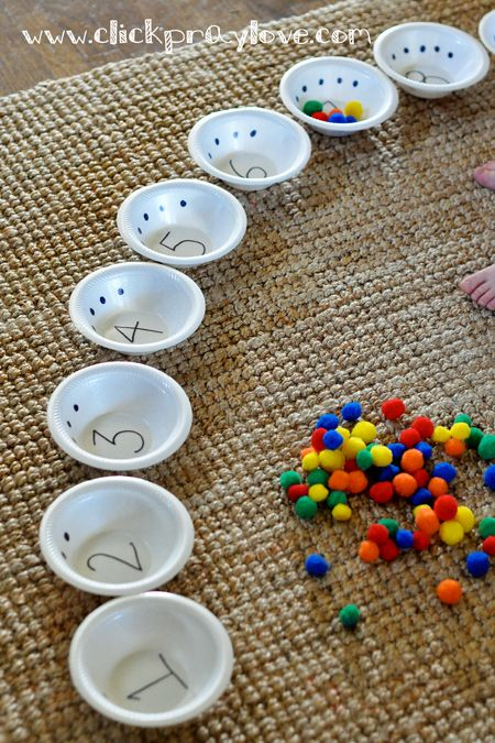COUNTING BOWLS. Label each bowl with the numbers 1 to 10 and add the same number of dots corresponding with the number on each bowl. Then, assist your child with placing the same number of balls (while counting aloud) inside the corresponding bowl. Then Turn the bowls upside down to hide the balls underneath and lift up to count the balls again