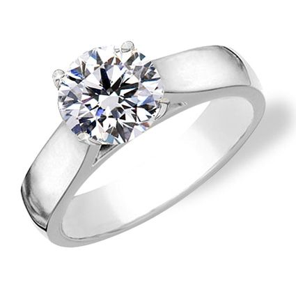 Round cut diamond solitaire engagement ring with cathedral shank. - Love the setting/style!!!
