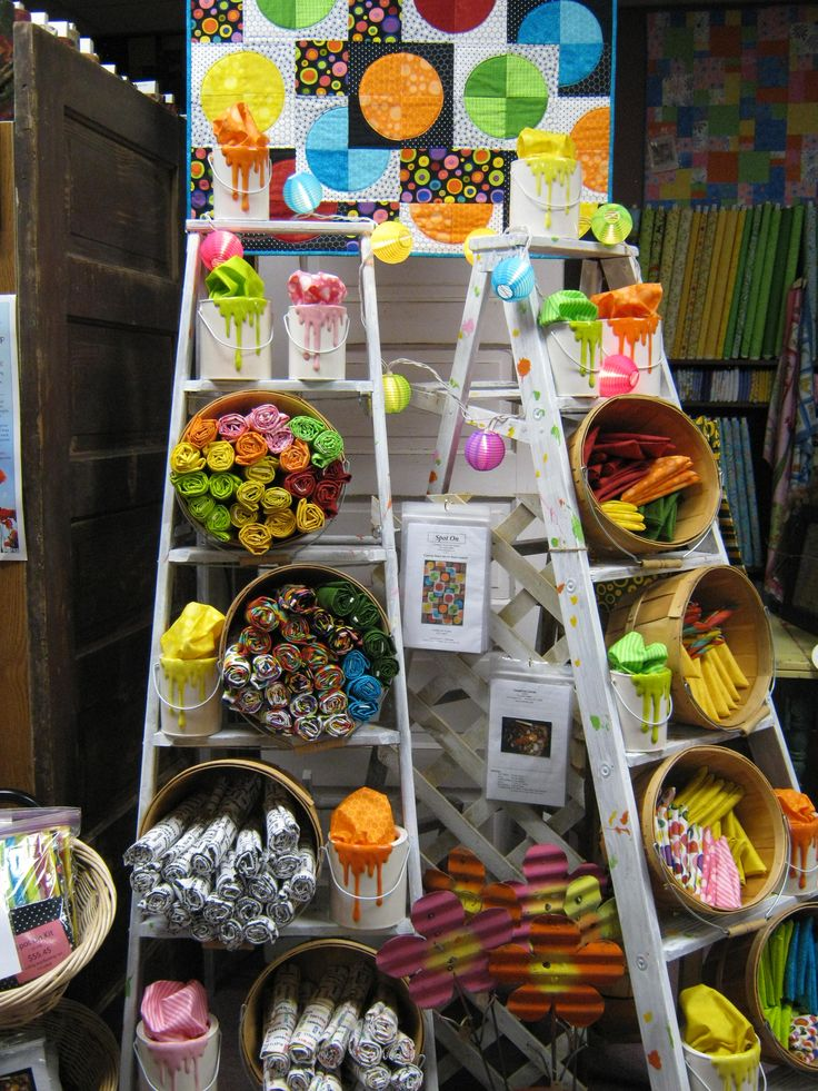 Decorative use of vintage ladders for arts and crafts show display, or retail store fixture, add baskets sideways for storage; Upcycle, recycle, salvage, diy, repurpose!  For ideas and goods shop at Estate ReSale  ReDesign, Bonita Springs, FL