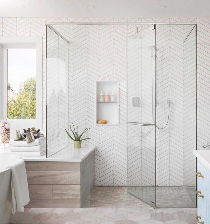 Walk In Shower With Floor To Ceiling White Herringbone Tile Glass Shower Doors Spa Like Bathroom Design Bath Bathroom Interior Design Home Bathroom Design