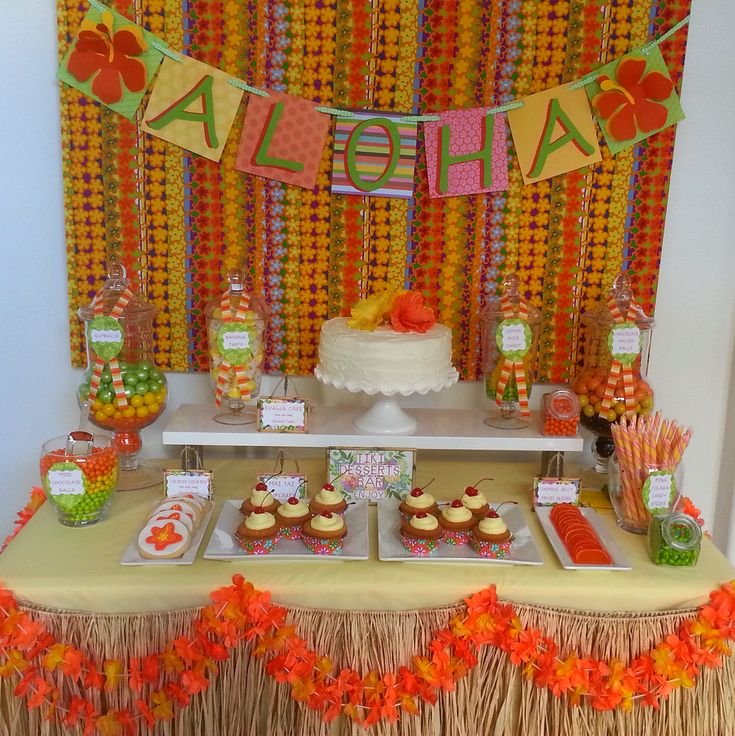 Pretty dessert table at a luau birthday party! See more party planning ideas at CatchMyParty.com!