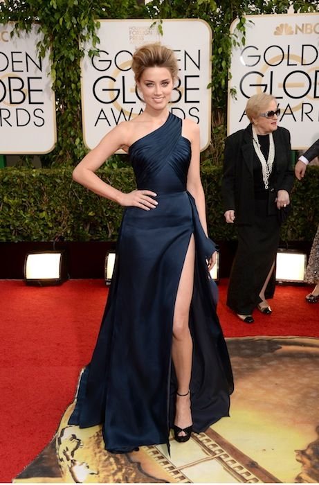 The 13 Biggest Fashion Moments From the Golden Globes: The new Angie's Right Leg: Amber Heard. At the 2012 Oscars, Angelina Jolie's black Atelier Versace gown featured a slit so high that the actress's exposed leg quickly became a meme, even spawning a successful parody Twitter account. Amber Heard -- who also wore Atelier Versace at the Golden Globes on Sunday night -- showed just as much leg, but sadly, the Internet hasn't gone quite so crazy for it.