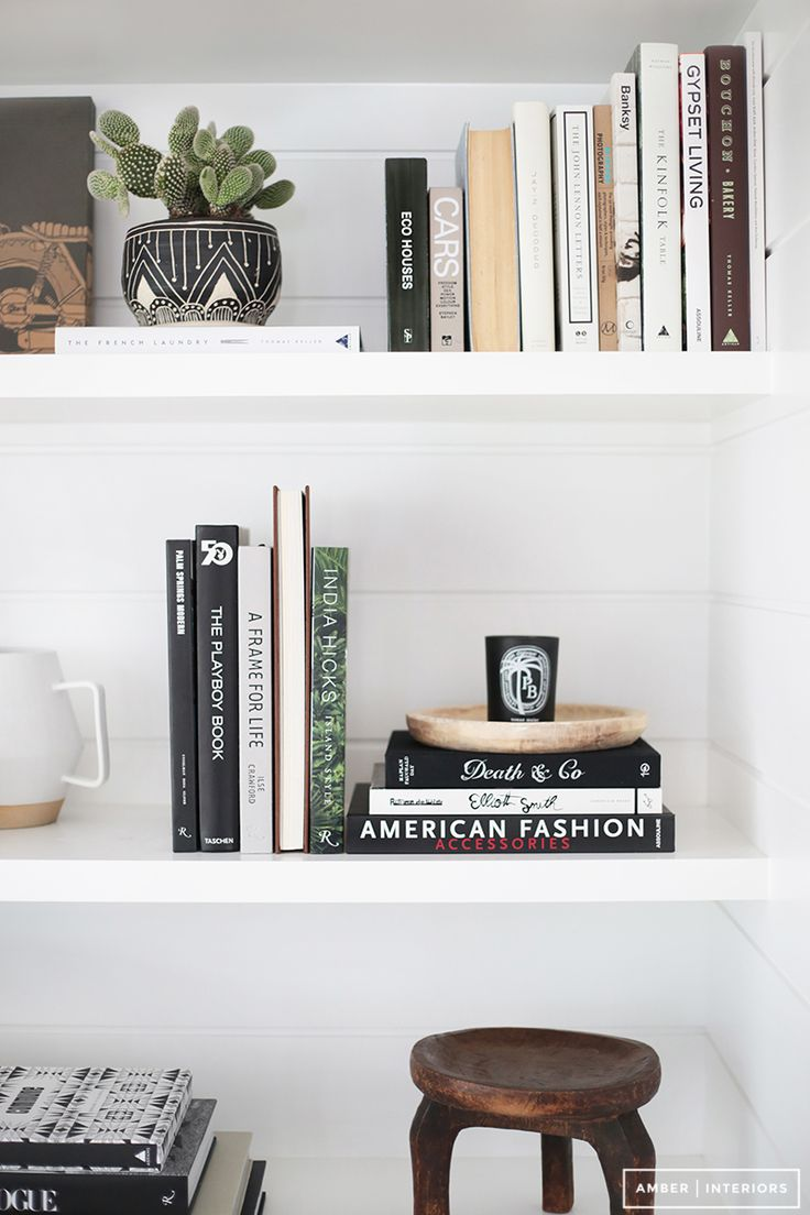 "Similar to shopping your own space for big pieces to rearrange, try switching up your ""shelfie"" by changing which items are on display. Small decorative objects, pretty books, and candles can all be rearranged for a completely new look. Move a favorite candle to your nightstand or try arranging your books by color."