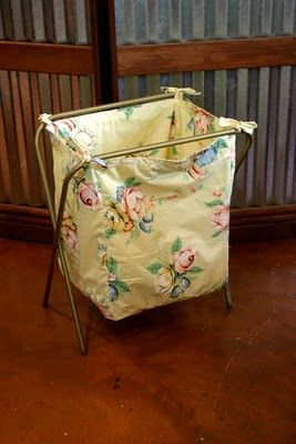 Laundry hamper from an old TV tray stand. Much prettier than plastic.