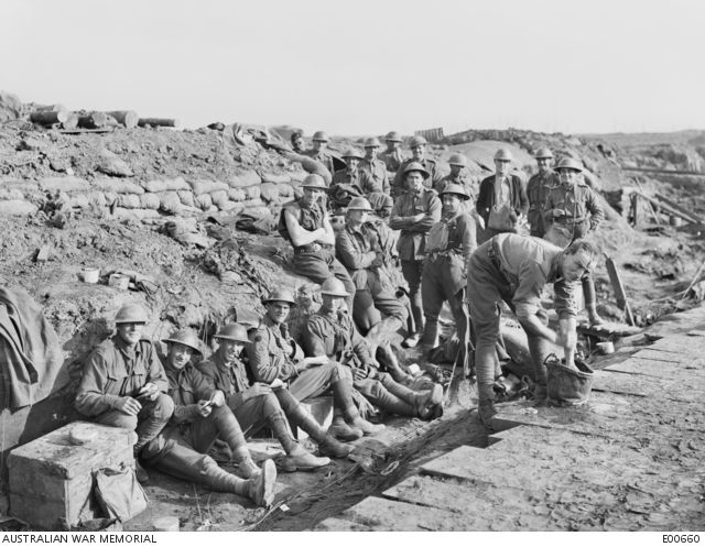 A group of unidentified soldiers of the 4th Australian Divisional Artillery outside their dugouts.