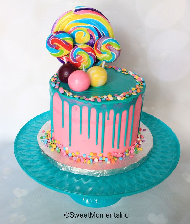 Pink and Teal Drip Cake with Candy and Confetti accents