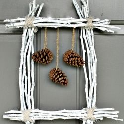 Create a unique winter wreath using twigs and pine cones.