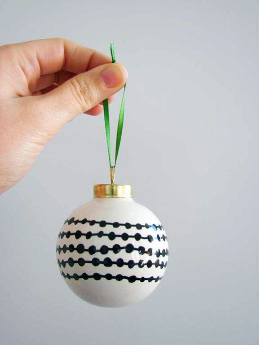 easy to do with a sharpie on any kind of ornament. Oil paint sharpies to make permanent