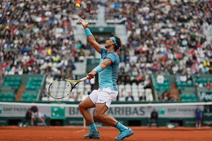 Spain's Rafael Nadal serves to Sam Groth of Australia during the first round of the French Open at Roland Garros