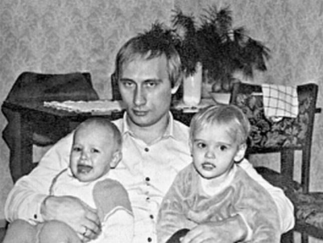 Putin and his 2 daughters 1985