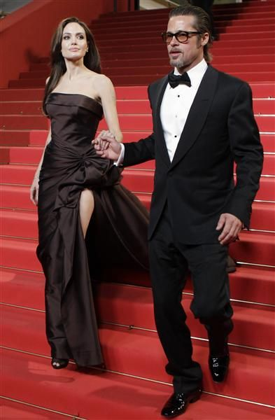 Angelina Jolie and Brad Pitt, at the 64th Cannes Film Festival. Angelina donned Atelier Versace on May 16, 2011.