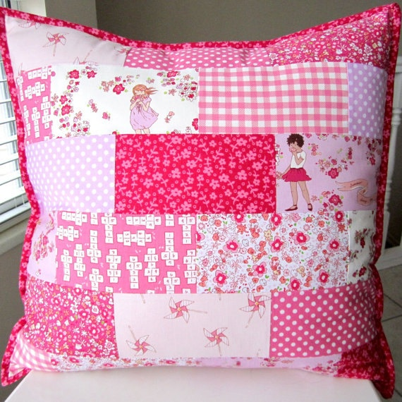 What a cute pillow! Love the fabrics used:)