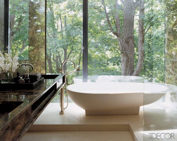 A Glass Bathroom  In the master bath of Glenn Pushelberg and George Yabu's home in Canada, a Spoon tub by G.P. Benedini for Agape overlooks ...
