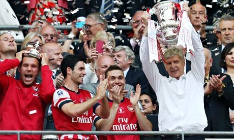 Arsenal manager Arsène Wenger lifts the FA Cup after the 3-2 extra-time win over Hull City. Photograph: Carl Recine/Action Images