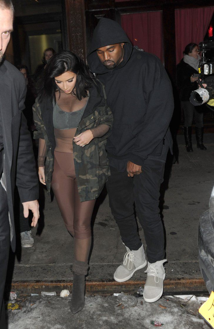 Pin for Later: 25 Times Kim Changed Her Outfit — and Kanye Wore His Sweatshirt When Kim dressed head-to-toe in some kind of body stocking at NYFW, but Kanye stuck to his basics.