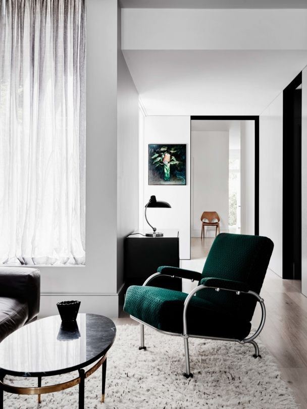 Living Rooms With Perfect Pops Of Color A Bright Forest Green Chair Ties In The This Artwork An Otherwise Grey And Black Toned Home By