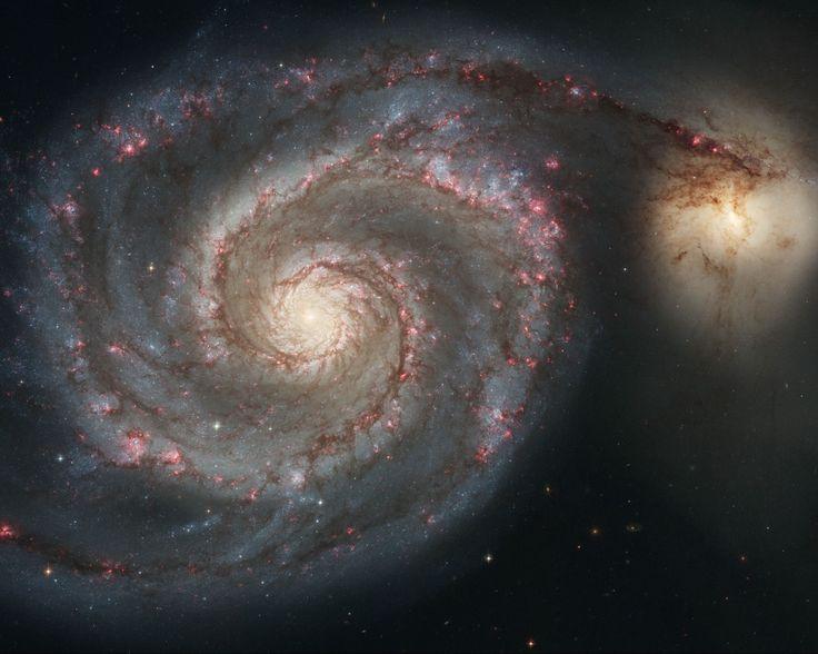 La galaxie du Tourbillon, un couple de galaxies situé à 27,4 millions…