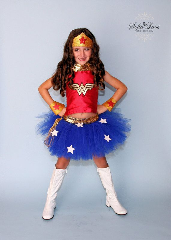 In this listing you will receive 1 Wonder Woman tutu and Halter with crown and cuffs . This tutu is made with yards and yards of royal blue tulle