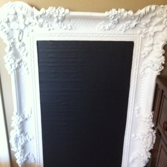 I spray painted this garage sale find white & added chalk board paint.