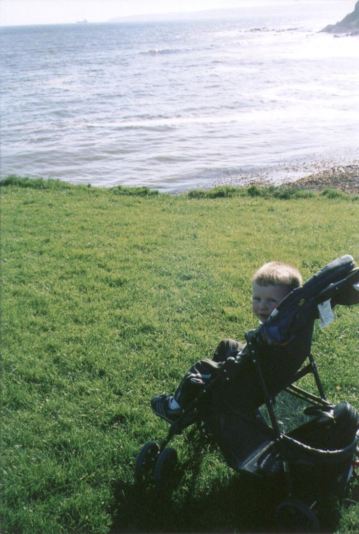 Kyle looking at the southern most point of Ireland...directly across the sea lies Spain. (2003)