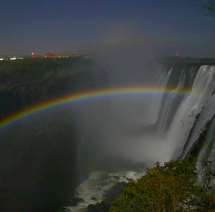 Have you ever seen a lunar rainbow? Most places on Earth must endure a storm and then await the sun before they can appreciate a rainbow. However for three days of the month - before during and after the full moon - the Victoria Falls harnesses shards of moonlight in a cloud of spray that rises from the base of the waterfall to create breathtaking lunar rainbows! Stars sit atop these beautiful arcs of colour that slice through thenight sky casting a beautiful and ethereal scene before you…