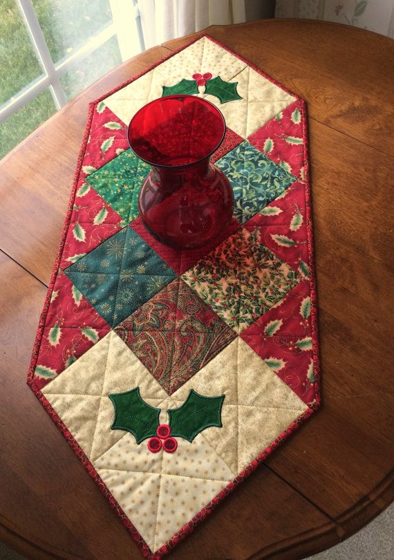 This beautiful Christmas quilt will look wonderful in the center of your dining table, on an end table or on your coffee table. It measures 12 1/4  x 31 1/4. It reverses to a winter theme.  It was handmade by me in a smoke free environment. It is machine washable, on a delicate cycle with cold water.
