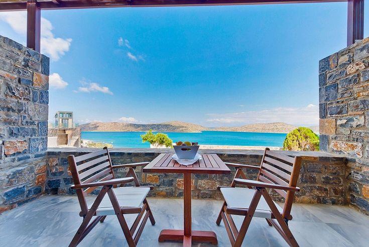 Breakfast with an unforgettable view: A balcony at Royal Marmin Bay Hotel which looks out over turquoise waters