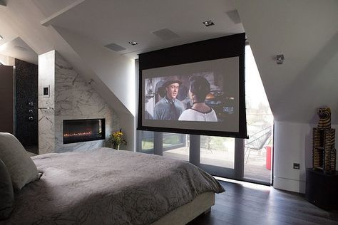 We nearly had a projector screen in place of tv at our master bedroom because one wall (leading to balcony) is all glass! Lucky we found the swivel rack mount which can hold the 50 inch tv and even rotate it for viewing at balcony! But we can still consider a projector at our next home!