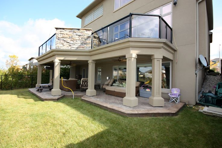 This large two level deck is built in ancaster ontario for 2 story porch columns