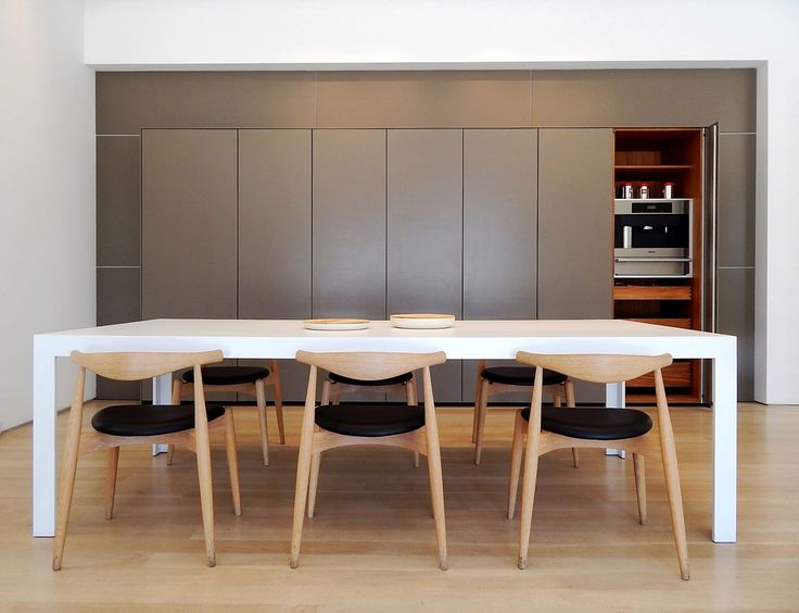 The bulthaup c2 table. Elbow Chairs originally designed by Hans J. Wegner and currently produced by Carl Hansen & Son. #kitchen #design  www.bulthaupsf.com
