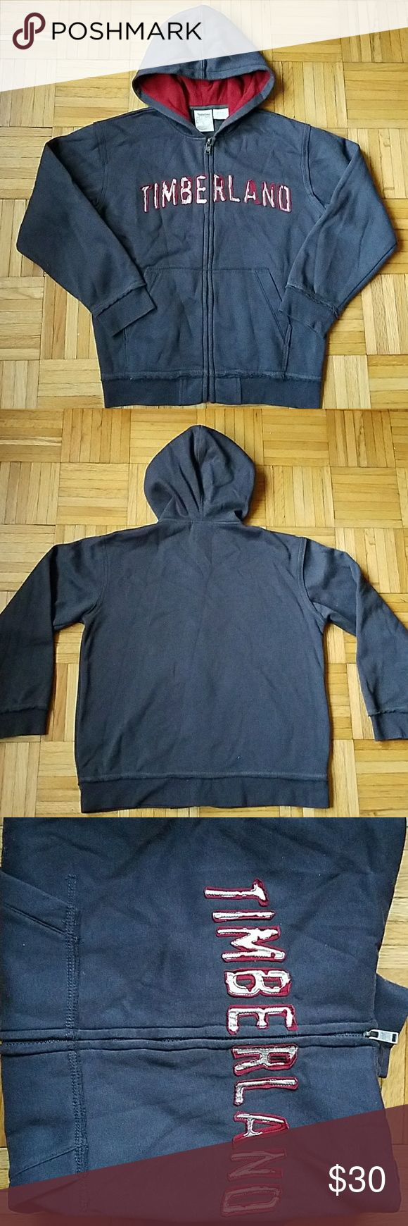 Timberland Hoodie Worn a couple of times! Timberland Distressed Logo Hoodie   -boy's size medium  (12-14) -distressed timberland logo (See 1st photo) and frayed edges around the upper part of the hem (See 4th photo). This is part of the design/style of the hoodie.  -color is charcoalish blue. Color looks slightly different in direct light. Timberland Jackets & Coats