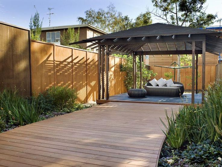 Wooden pergola seating area.  This is the kind of structure I'd like over a corner deck that steps down to the built-in spa