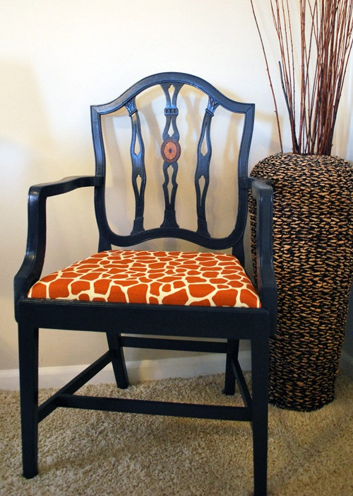 Vivien: Navy side chair with orange giraffe-print seat We can re create this look with antique chairs painted out and re covered as side chairs in the tv room!