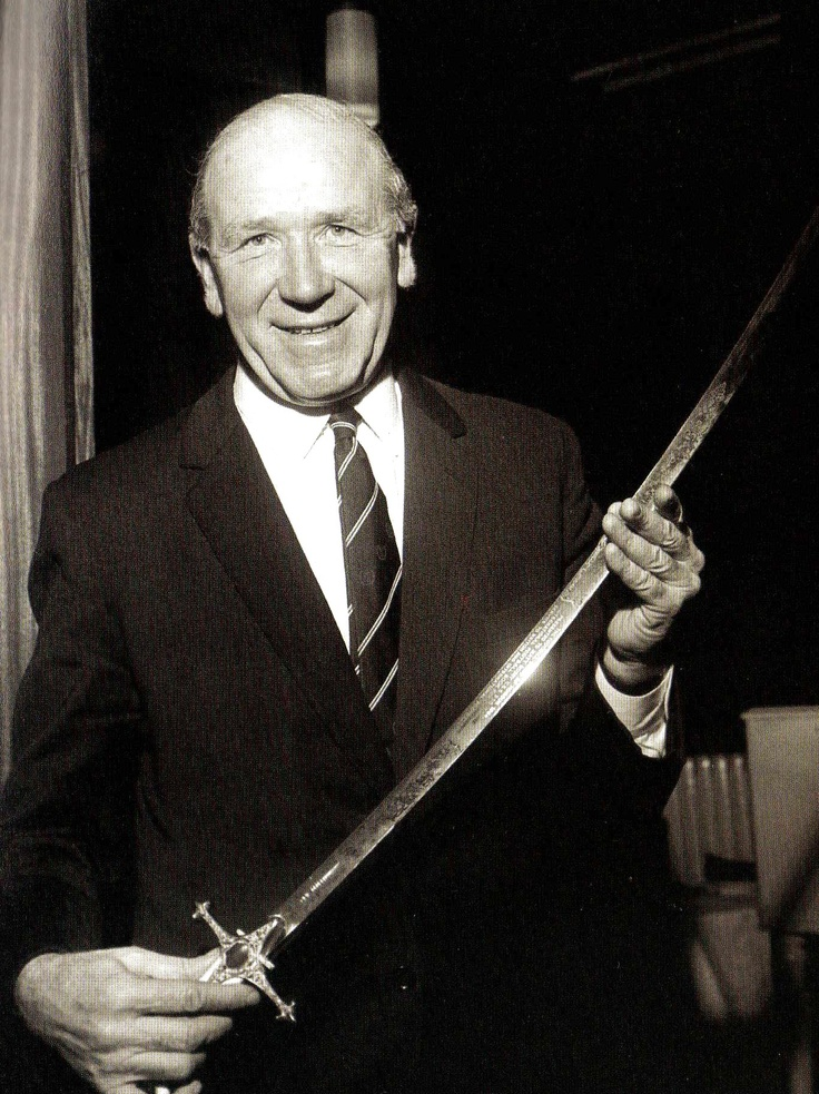 Manchester United manager Matt Busby, the first recipient of the Football Sword of Honour, presented to him in Manchester for 'distinguished service to British and International football' - 2 December 1964