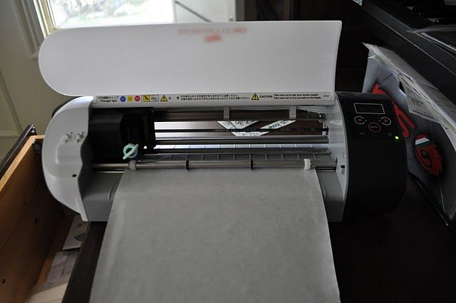Cutting freezer paper with the Silhouette! I love this blog! I asked her what setting she used then she does a full post about it! I'm sure she gets asked all the time because she makes the greatest shirts for her boys! She's the bomb!