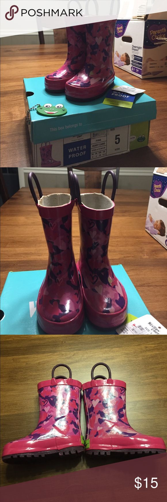 Like new Western Chief rain boots w/ box and tags Like new! Western Chief pink and Purple Heart camp little rain boots. Used for 2 months tops! Still have original box and tags. Small irregularity on the print (pictured), they came that way. Ordered online from Target. Western Chief Shoes Rain & Snow Boots