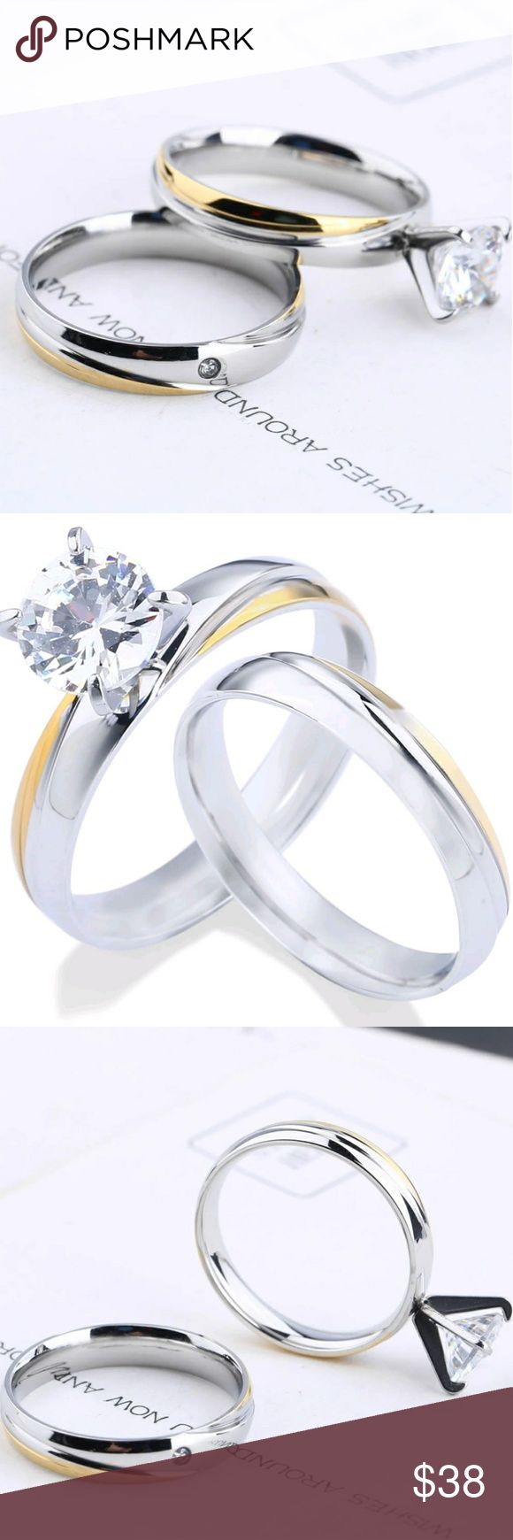 NWT Stainless Steel Wedding Set Size 6 A uniquely designed gold and silver color with a small cz in the band. The large cz is 2 karats. Stunningly beautiful. Jewelry Rings