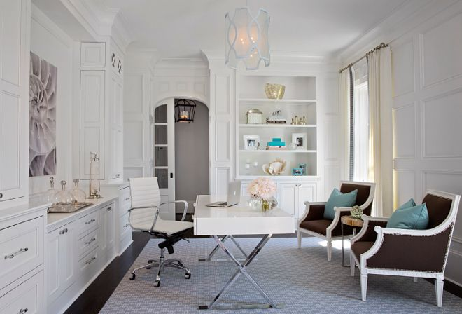 """Home Office. This has to be the ultimate home office. I love the millwork, the decor and the furniture. The home office boasts polished chrome x-base desk with white lacquer top paired with white Eames Management Chair. The office also features full wall millwork as well as floor-to-ceiling white built-in cabinets. Dimensions: This room is 13'-10 wide (Left to Right) by 16'-4"""" length (Front to Back). #homeoffice #millwork #cabinets TS Adams Studio Architects. Traci Rhoads Interiors."""