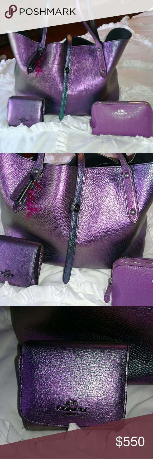 Coach HOLOGRAM IRIDESCENT Market Tote SET Absolutely stunning!  Large market tote,  gorgeous hologram rainbow color.   Tote has a few marks,  plz see extra pic listing.  Coach hologram trifold wallet.   Purple Coach cosmetic bag.   Pink hangtag Coach Bags